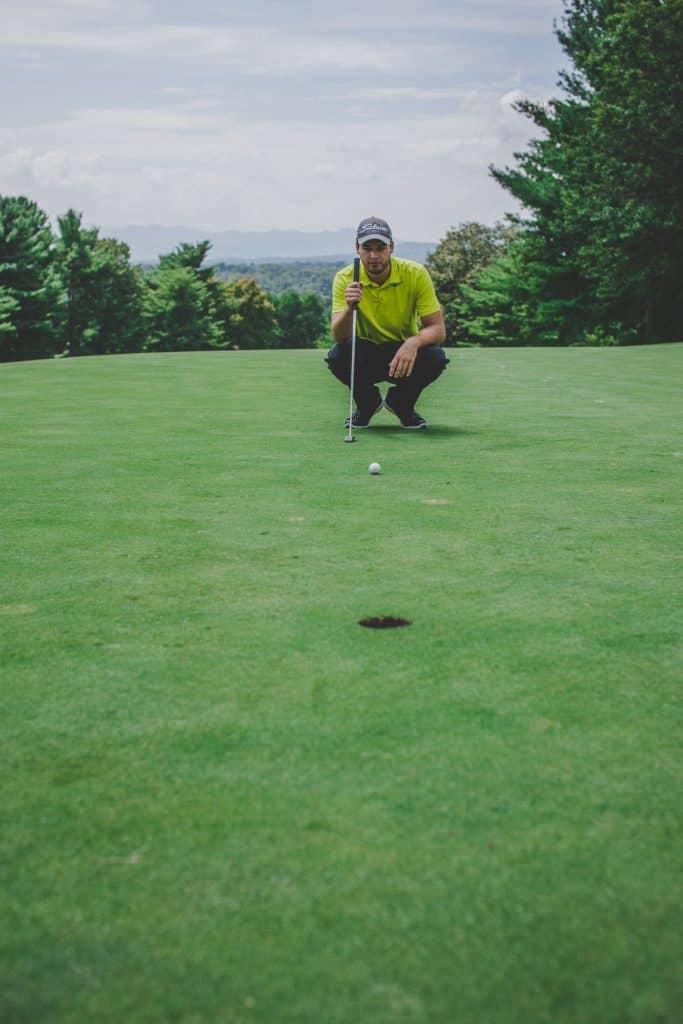 Golfer lining up his putt